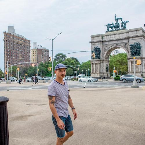 michael from coolcousin in front of grand army plaza in brooklyn