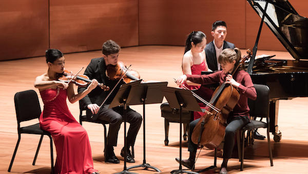 students performing chamber music onstage