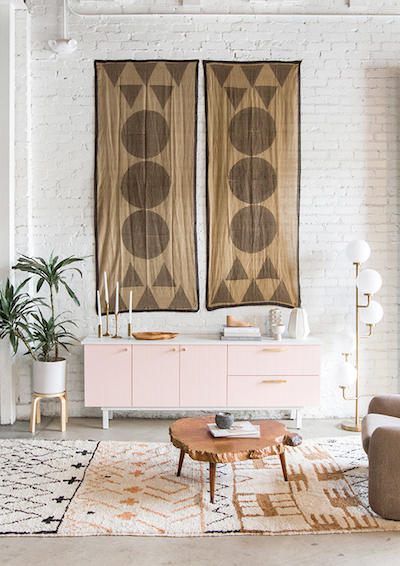 oversized tapestry art hangs from a bohemian room