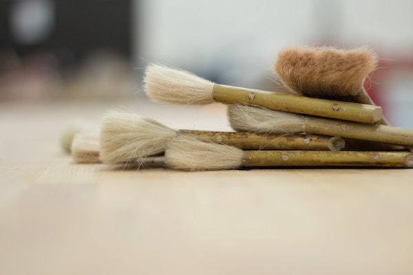 a pile of clean brushes lie stacked together on a table