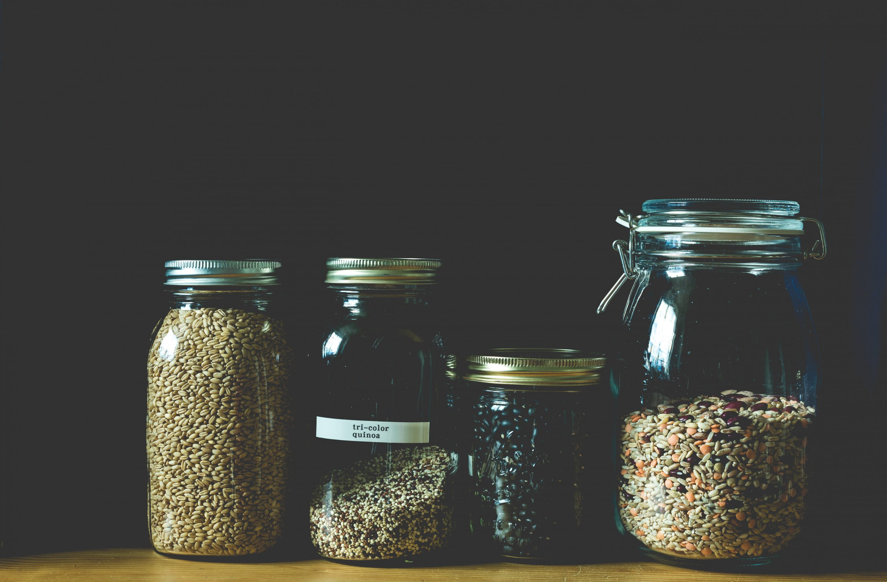 a collection of dried goods in mason jars