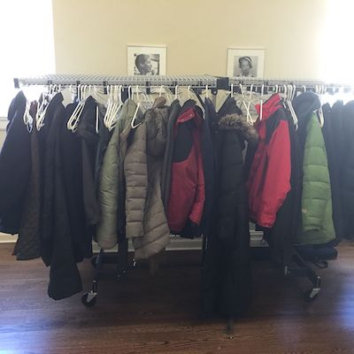 similar winter coats hung together on rack