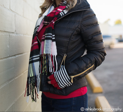 black puffer coat with plaid scarf and red sweater