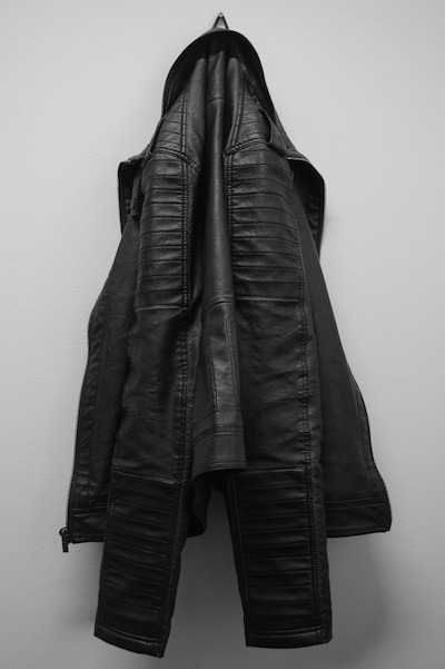 hanging black leather jacket
