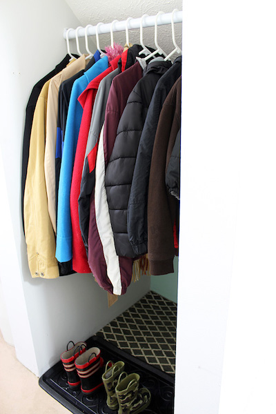 coats in dry dark coat closet