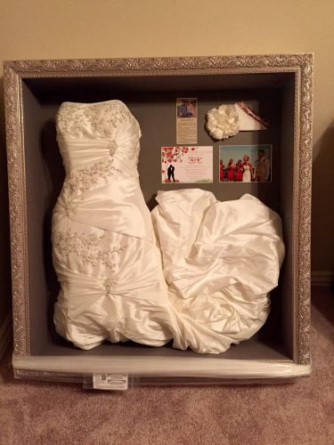 a wedding dress stored in a shadow box
