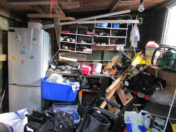cluttered garage with messy shelves