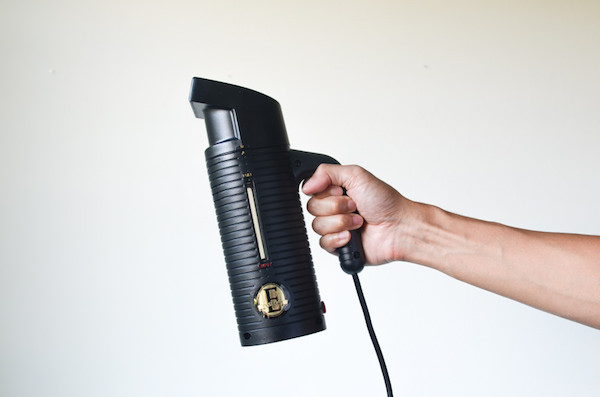 black handheld clothes steamer