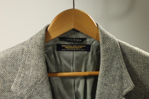 brooks brothers herringbone suit on wooden hanger