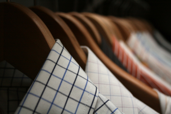 dress shirts hanging on wooden hangers