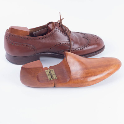 cedar shoe tree with brown leather men's shoe