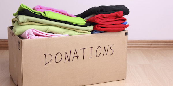 clothing donation in a cardboard box