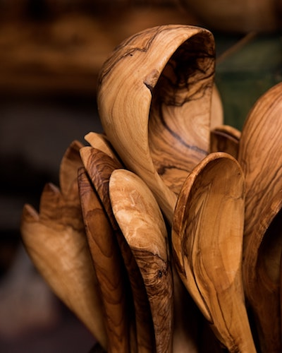 multiple wooden spoons grouped together