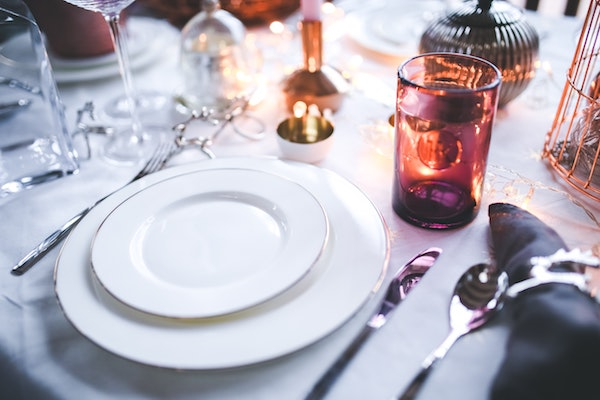 white plates place setting at a dinner party