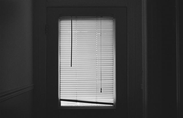 a dark window in a bedroom
