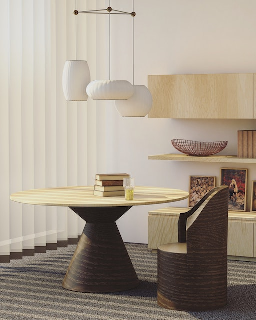 a white round table with white hanging light fixtures