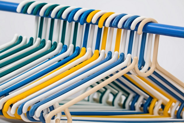 bright yellow and blue plastic hangers