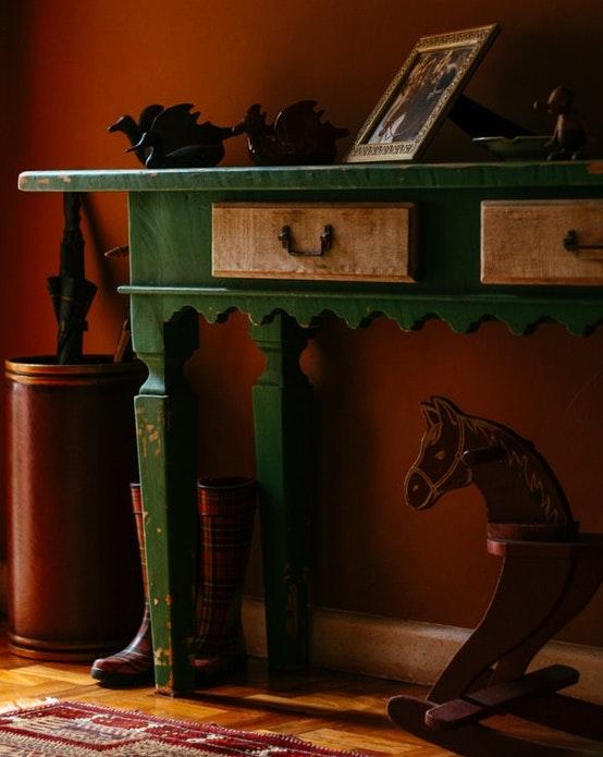 a green vintage sideboard