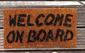 a floor mat that reads welcome on board