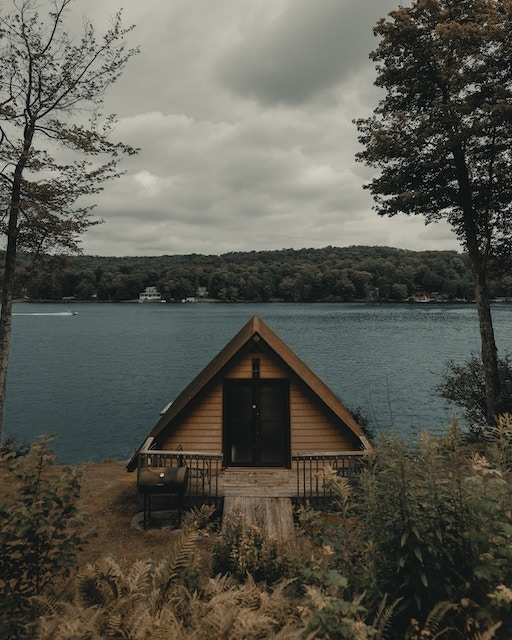 a tiny house by a lake
