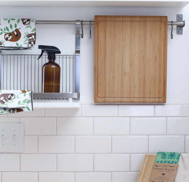 a kitchen counter wall with hanging caddy