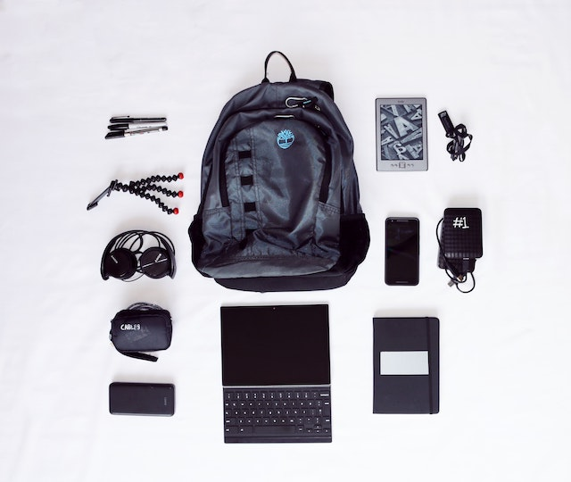 a backpack, a computer and a notebook