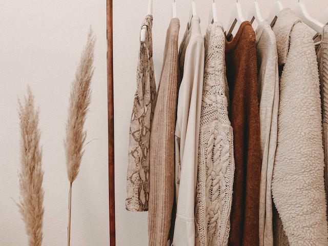 sweaters hanging in a closet