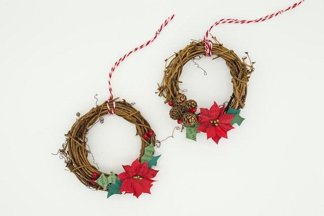 Holiday wreaths agaist a white background