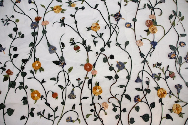 a floral pattern against a marble texture