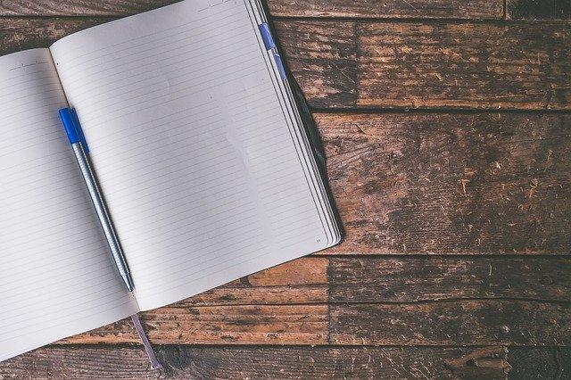 A journal against a wooden backgorund