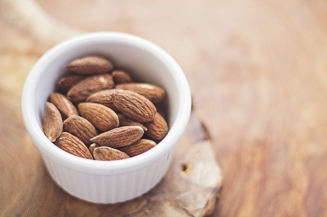 a cup full of raw almonds