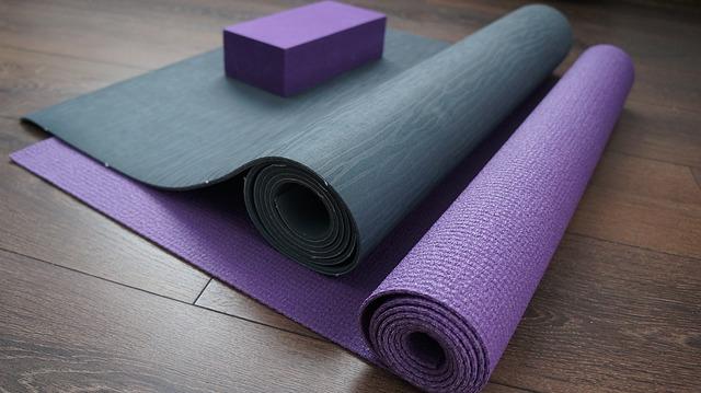 two yoga mats on a hardwood floor