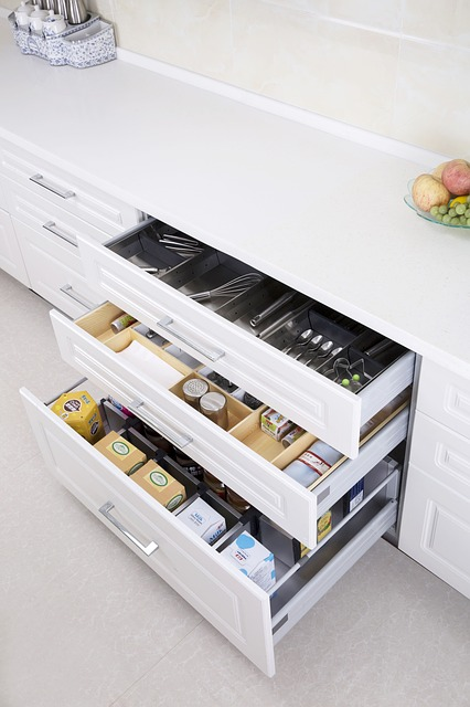Kitchen drawers filled with separators and neatly arranged utensils