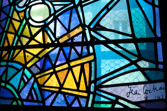 A window with stained glass features