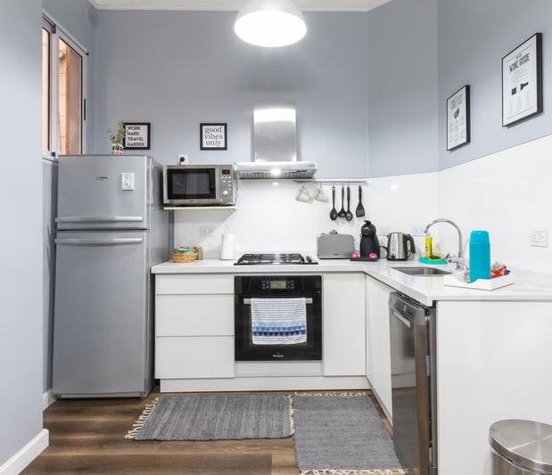 A clean kitchen with pristine appliances