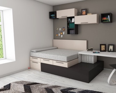 A bed with little shelves on a side-wall