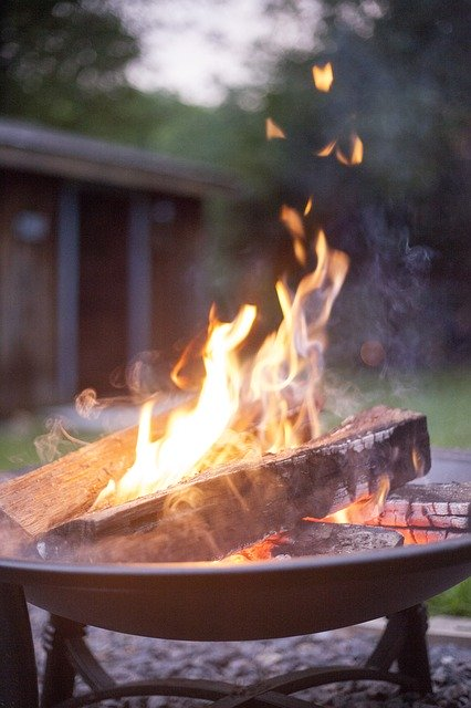 A small campfire in the backyard