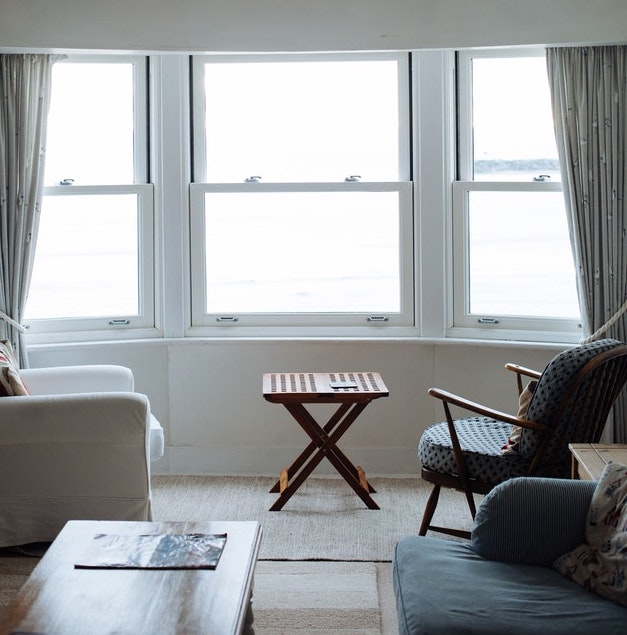 Three clean, bright windows in a living room