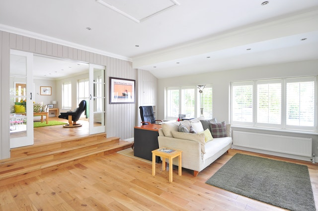 A spacious room covered with clean oak hardwood floors