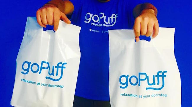 A person holding bags of gopuff