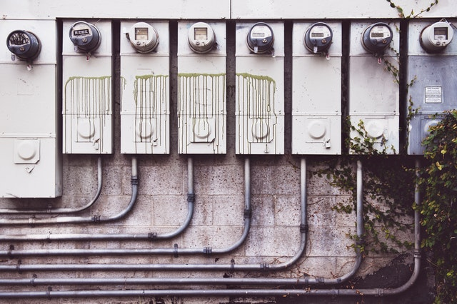 Electricity meters in a line.