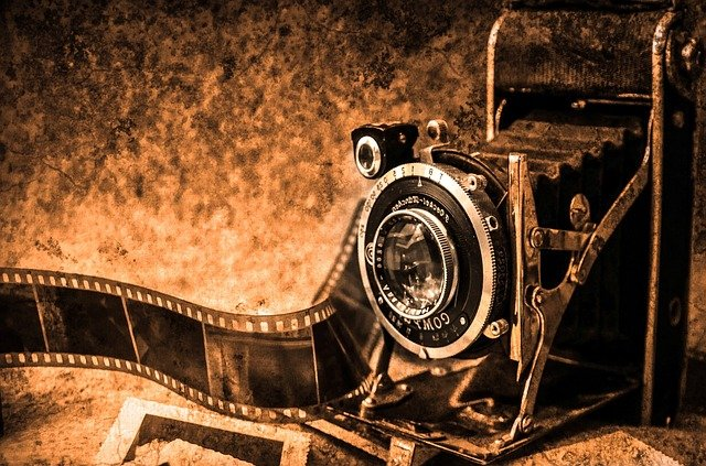 A sepia-set old camera with film