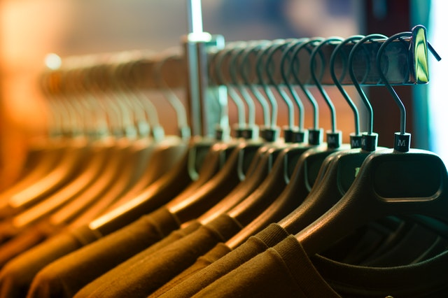 Clothes on hangers in a row