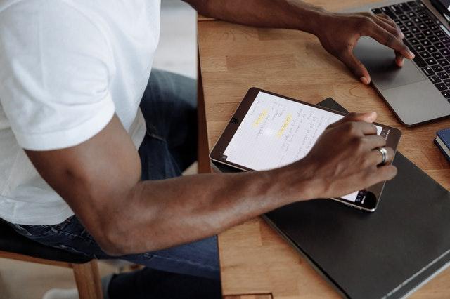 A man planning on an ipad