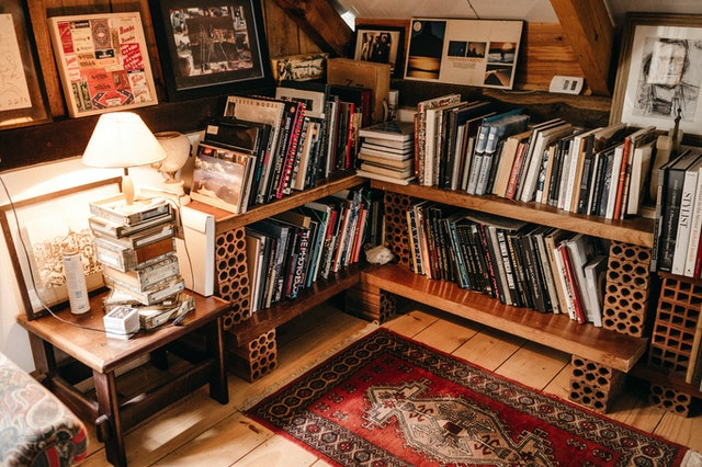 An angled corner in the attic filled with L-shaped shelves