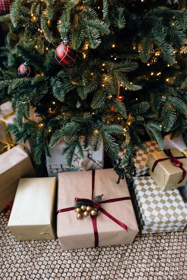 Gifts wrapped under a decorated christmas tree