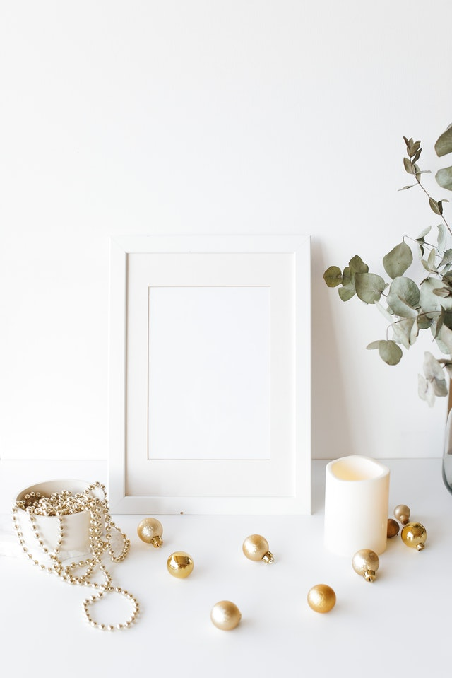 Golden Christmas ornaments against a white backdrop