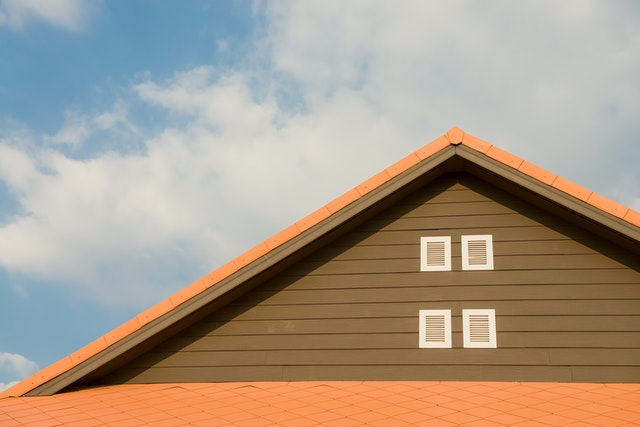 A house with a roof against a blue sky.