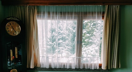 A window facing snow trees