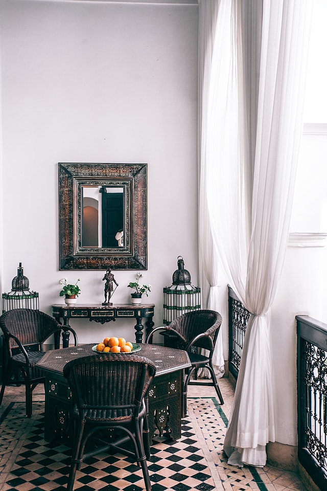 A balcony with a table and chairs